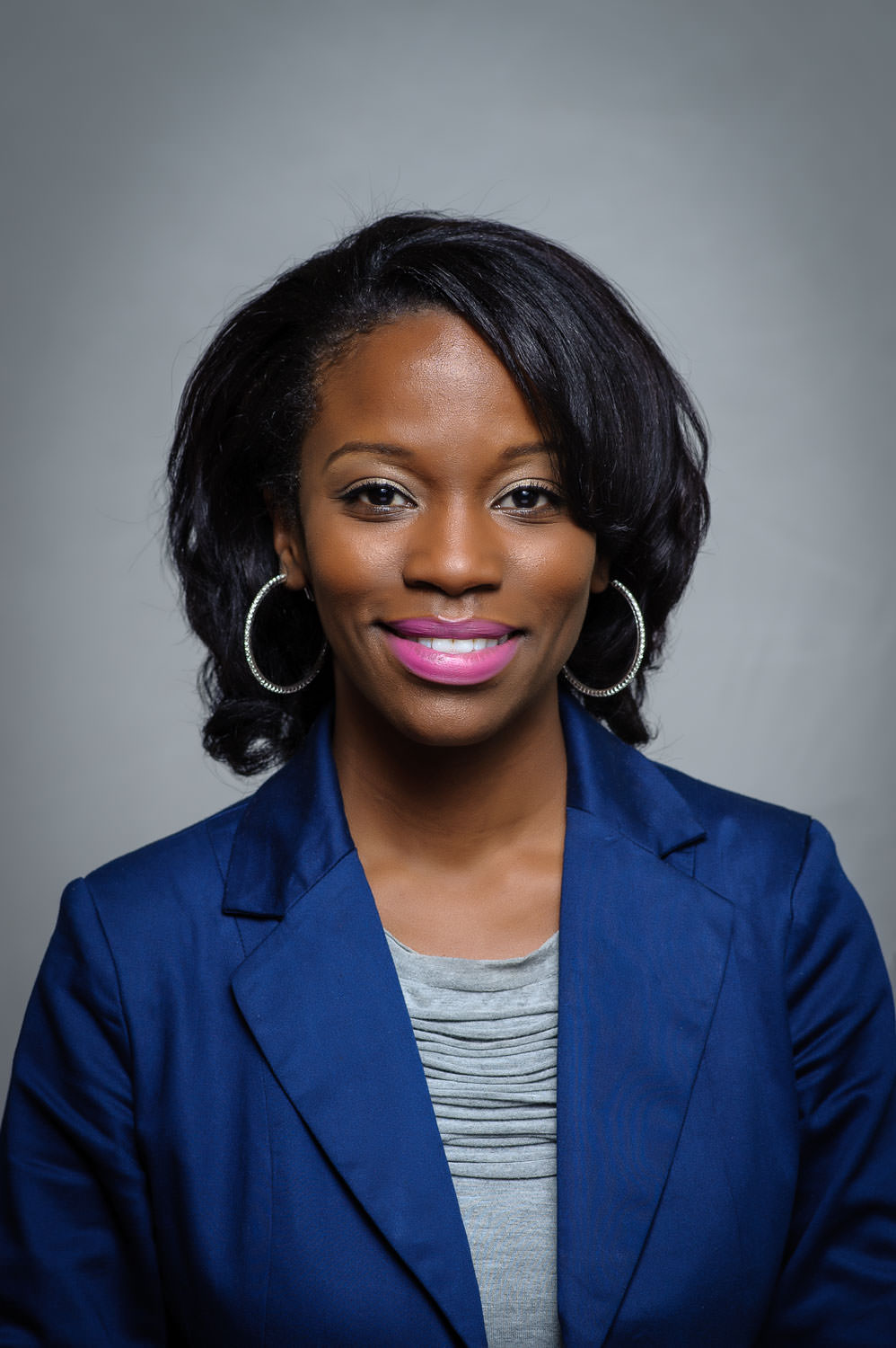 professional headshot photo of a smiling African-American woman