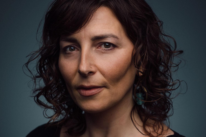 professional studio headshot of middle age woman