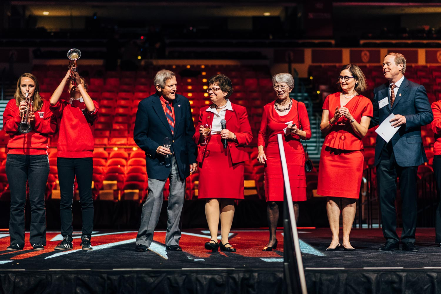 executives of UW are singing during the opening ceremony of corporate event in Madison, Wisconsin