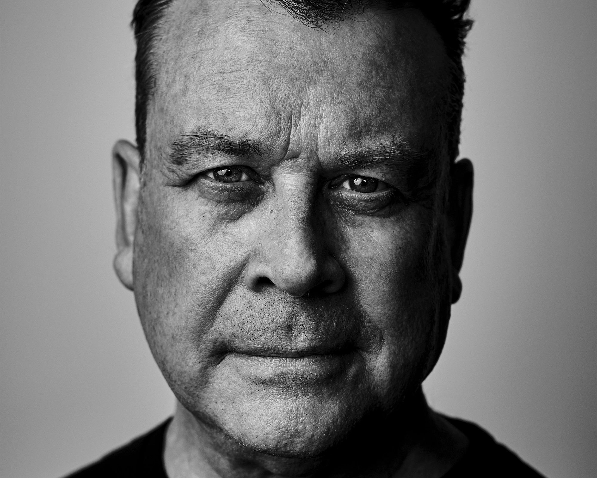 in-studio business headshot of a freelance writer and film producer