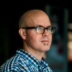 Executive headshot of an art director