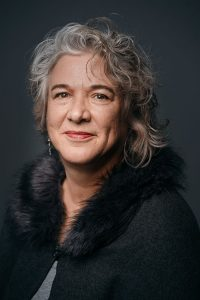 Dramatic in-studio portrait of a middle aged woman