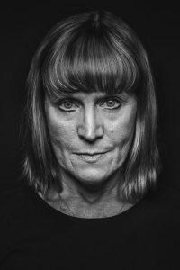 close-up in studio portrait of cancer survivor